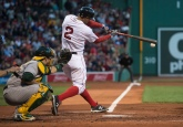 BOSTON, MA - MAY 9: Xander Bogaerts #2 of the Boston Red Sox hits a double against the Oakland Athletics in the first inning on May 9, 2016 at Fenway Park in Boston, Massachusetts. (Photo by Michael Ivins/Boston Red Sox/Getty Images) *** Local Caption *** Xander Bogaerts