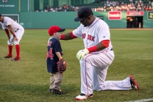 BOSTON, MA - MAY 11: Maverick Schutte of Cheyenne, Wyoming talks with David Ortiz #34 of the Boston Red Sox on May 11, 2016 at Fenway Park in Boston, Massachusetts. Schutte has undergone more than 30 surgical procedures because of a congenital heart defect and on Friday May 7th Ortiz delivered on a promise to him and hit a home run against the Yankees in New York. (Photo by Michael Ivins/Boston Red Sox/Getty Images) *** Local Caption *** David Ortiz;Maverick Schutte