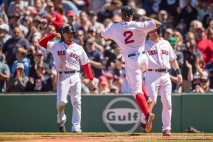 BOSTON, MA - MAY 15: Xander Bogaerts #2 of the Boston Red Sox reacts with Ryan Hanigan #10 and Mookie Betts #50 after hitting a three run home run during the second inning of a game against the Houston Astros on May 15, 2016 at Fenway Park in Boston, Massachusetts. (Photo by Billie Weiss/Boston Red Sox/Getty Images) *** Local Caption *** Xander Bogaerts; Ryan Hanigan; Mookie Betts