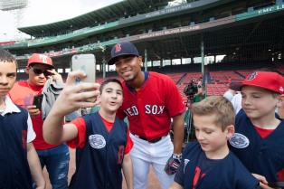 Boston, MA - May 25: Selfies with Bogaerts were a hit during batting practice prior to the Colorado Rockies vs. Boston Red Sox game on May 25, 2016 at Fenway Park in Boston, Massachusetts . (Photo by Simone Schiess/Boston Red Sox)