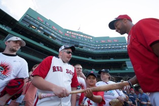 Boston, MA - May 25: Chris Young meets fans and signs autographs during the Boston Red Sox batting practice on May 25, 2016 at Fenway Park in Boston, Massachusetts . (Photo by Simone Schiess/Boston Red Sox)