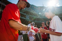 Boston, MA - July 19: Eli Goldstein, from the Make-A-Wish Foundation, has his ball signed by Mookie Betts during batting practice before the San Francisco Giants vs. Boston Red Sox game on July 19, 2016 at Fenway Park in Boston, Massachusetts . (Photo by Simone Schiess/Boston Red Sox)