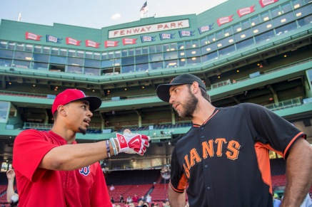 BOSTON, MA - JULY 19: Mookie Betts #50 of the Boston Red Sox talks with Madison Bumgarner #40 of the San Francisco Giants before a game on July 19, 2016 at Fenway Park in Boston, Massachusetts. (Photo by Billie Weiss/Boston Red Sox/Getty Images) *** Local Caption *** Mookie Betts; Madison Bumgarner