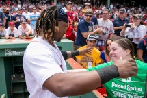 BOSTON, MA - JULY 24: Hanley Ramirez #13 of the Boston Red Sox hugs a fan before a game against the Minnesota Twins on July 24, 2016 at Fenway Park in Boston, Massachusetts. (Photo by Billie Weiss/Boston Red Sox/Getty Images) *** Local Caption *** Hanley Ramirez