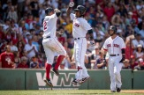 BOSTON, MA - JULY 24: Hanley Ramirez #13 of the Boston Red Sox reacts with Xander Bogaerts #2 and Dustin Pedroia #15 after hitting a three run home run during the third inning of a game against the Minnesota Twins on July 24, 2016 at Fenway Park in Boston, Massachusetts. (Photo by Billie Weiss/Boston Red Sox/Getty Images) *** Local Caption *** Hanley Ramirez; Dustin Pedroia; Xander Bogaerts