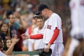 BOSTON, MA - AUGUST 13: Brad Ziegler #29 of the Boston Red Sox walks to the dugout after getting out of a bases loaded jam with no outs against the Arizona Diamondbacks in the eighth inning on August 13, 2016 at Fenway Park in Boston, Massachusetts. (Photo by Michael Ivins/Boston Red Sox/Getty Images) *** Local Caption *** Brad Ziegler