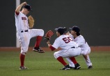 BOSTON, MA - AUGUST 13: Brock Holt #12, Mookie Betts #50 and Andrew Benintendi #40 of the Boston Red Sox celebrate a 6-3 win against the Arizona Diamondbacks on August 13, 2016 at Fenway Park in Boston, Massachusetts. (Photo by Michael Ivins/Boston Red Sox/Getty Images) *** Local Caption *** Brock Holt;Mookie Betts;Andrew Benintendi