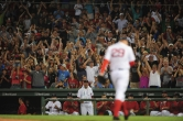 BOSTON, MA - August 13: Matt Barnes cheers as Brad Ziegler walks off the mound after striking out three batters with the bases loaded in the 8th inning of the Boston Red Sox game against the Arizona Diamondbacks on August 13, 2016 at Fenway Park in Boston, Massachusetts. (Photo by Mark Clavin/Boston Red Sox)