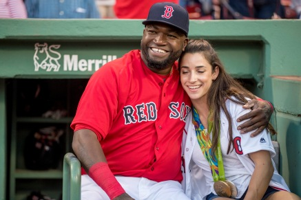 BOSTON, MA - AUGUST 26: Olympic gymnast Aly Raisman reacts with David Ortiz #34 of the Boston Red Sox before throwing out a ceremonial first pitch before a game against the Kansas City Royals on August 26, 2016 at Fenway Park in Boston, Massachusetts. (Photo by Billie Weiss/Boston Red Sox/Getty Images) *** Local Caption *** David Ortiz; Aly Raisman
