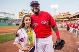 BOSTON, MA - AUGUST 26: Olympic gymnast Aly Raisman poses with David Ortiz #34 of the Boston Red Sox before throwing out a ceremonial first pitch before a game against the Kansas City Royals on August 26, 2016 at Fenway Park in Boston, Massachusetts. (Photo by Billie Weiss/Boston Red Sox/Getty Images) *** Local Caption *** David Ortiz; Aly Raisman