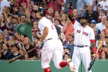 BOSTON, MA - AUGUST 27: David Ortiz #34 reacts as Xander Bogaerts #2 of the Boston Red Sox hits a two run home run during the first inning of a game against the Kansas City Royals on August 27, 2016 at Fenway Park in Boston, Massachusetts. (Photo by Billie Weiss/Boston Red Sox/Getty Images) *** Local Caption *** Xander Bogaerts; David Ortiz