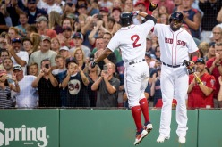 BOSTON, MA - AUGUST 27: Xander Bogaerts #2 of the Boston Red Sox high fives David Ortiz #34 after hitting a two run home run during the first inning of a game against the Kansas City Royals on August 27, 2016 at Fenway Park in Boston, Massachusetts. (Photo by Billie Weiss/Boston Red Sox/Getty Images) *** Local Caption *** Xander Bogaerts; David Ortiz