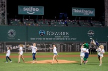 BOSTON, MA - AUGUST 28: Olympic medalists Abbey D'Agostino, Tessa Gobbo, Eleanor Logan, Genevra Stone, Mike Hixon, and Kayla Harrison throw out a ceremonial first pitch before a game between the Boston Red Sox and the Kansas City Royals on August 28, 2016 at Fenway Park in Boston, Massachusetts. (Photo by Billie Weiss/Boston Red Sox/Getty Images) *** Local Caption *** Abbey D'Agostino; Tessa Gobbo; Eleanor Logan; Genevra Stone; Mike Hixon; Kayla Harrison
