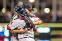 BALTIMORE, MD - SEPTEMBER 19: Rick Porcello #22 hugs Sandy Leon #3 of the Boston Red Sox after pitching a complete game against the Baltimore Orioles on September 19, 2016 at Oriole Park at Camden Yards in Baltimore, Maryland. (Photo by Billie Weiss/Boston Red Sox/Getty Images) *** Local Caption *** Rick Porcello; Sandy Leon