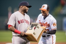 BALTIMORE, MD - SEPTEMBER 22: Adam Jones #10 of the Baltimore Orioles presents a replica dugout phone to David Ortiz #34 of the Boston Red Sox during an honorary pre game ceremony for Ortiz before a game on September 22, 2016 at Oriole Park at Camden Yards in Baltimore, Maryland. (Photo by Billie Weiss/Boston Red Sox/Getty Images) *** Local Caption *** Adam Jones; David Ortiz