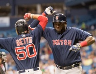 ST. PETERSBURG, FL - SEPTEMBER 23: David Ortiz #34 of the Boston Red Sox celebrates with Mookie Betts #50 after hitting a two-run home run against the Tampa Bay Rays in the first inning on September 23, 2016 at Tropicana Field in St. Petersburg, Florida. (Photo by Michael Ivins/Boston Red Sox/Getty Images) *** Local Caption *** David Ortiz