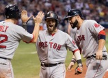 ST. PETERSBURG, FL - SEPTEMBER 24: Dustin Pedroia #15 of the Boston Red Sox is congratulated by Sandy Leon #3 and Brock Holt #12 after a grand slam against the Tampa Bay Rays in the seventh inning on September 24, 2016 at Tropicana Field in St. Petersburg, Florida. (Photo by Michael Ivins/Boston Red Sox/Getty Images) *** Local Caption *** Dustin Pedroia