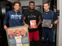 ST. PETERSBURG, FL - SEPTEMBER 25: David Ortiz #34 of the Boston Red Sox receives gifts from Chris Archer #22 and Evan Longoria #3 of the Tampa Bay Rays on September 25, 2016 in the visitors clubhouse at Tropicana Field in St. Petersburg, Florida. Ortiz had declined a public ceremony out of respect for recently deceased Florida Marlins pitcher Jose Fernandez. Photo by Michael Ivins/Boston Red Sox/Getty Images) *** Local Caption *** David Oritz;Evan Longoria;Chris Archer