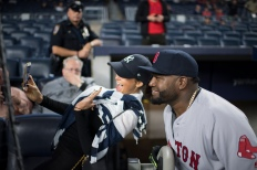 NEW YORK, NY - SEPTEMBER 28: David Ortiz #34 of the Boston Red Sox takes a picture with a fan before a game against the New York Yankees on September 28, 2016 at Yankee Stadium in the New York, NY. (Photo by Michael Ivins/Boston Red Sox/Getty Images) *** Local Caption *** David Ortiz