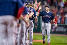 CLEVELAND, OH - OCTOBER 6: Andrew Benintendi #40 of the Boston Red Sox high fives teammatesl before game one of the American League Division Series against the Cleveland Indians on October 6, 2016 at Progressive Field in Cleveland, Ohio. (Photo by Billie Weiss/Boston Red Sox/Getty Images) *** Local Caption *** Andrew Benintendi